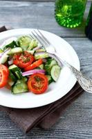 salad with cucumbers and tomatoes photo