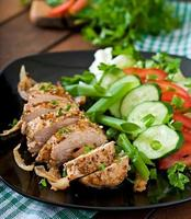 Baked chicken breast and fresh vegetables