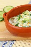 Cucumber salad with sour cream and fresh dill in bowl