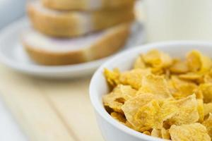 Golden Cornflakes (detailed close-up shot) on an old wooden tabl