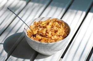 making a bowl of cornflakes and  spoon photo