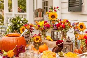 Fall Autumn Table With Sun Flowers and Pumpkins