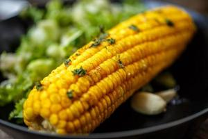 Baked corn with salad photo