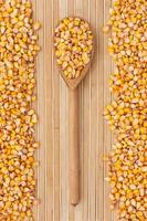 Wooden spoon with corn lying