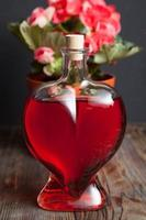 Bottle with red wine and flower