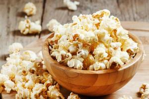 Sweet caramel popcorn in a wooden bowl
