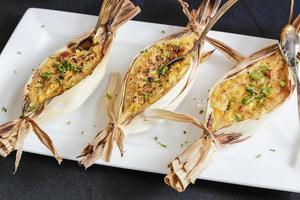 corn pudding in the corn husk boat