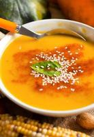 Fresh pumpkin soup with a spoon