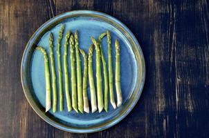 Asparagus on blue dish