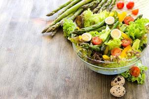 Fresh mix salad with green asparagus and eggs