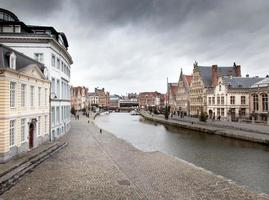 Buildings along a river, River Lys, Ghent, Belgium photo
