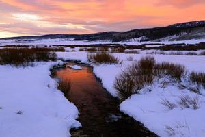 Winter river sunrise.