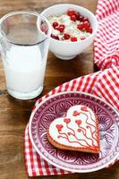 Valentine cookies on a plate with milk