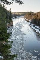 frozen river in winter photo
