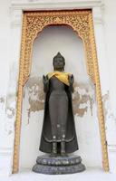 Row of Sacred Buddha images in photo