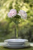 Romantic place setting with pink peonies