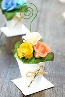 bouquet of paper rose in vase photo