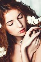 Beautiful girl with cotton plant photo
