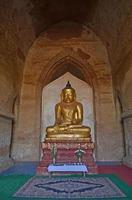 Buddha statue into the temple. Bagan, Myanmar (Burma)