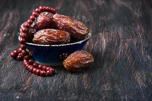 Dates fruit and rosary still life photo