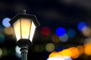 Street lamp with festive abstract bokeh background photo