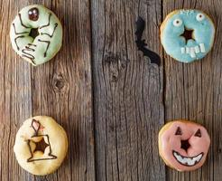Halloween donuts on wooden table