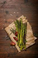 Roasted green asparagus on wooden background
