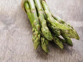 bunch of green asparagus tied with twine photo