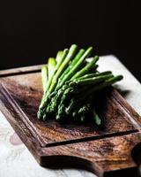 Bunch of fresh green asparagus spears tied with twine photo