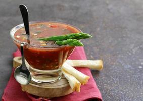 traditional Spanish cold tomato soup gazpacho with asparagus and crackers