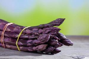 Bunch of violet asparagus on wood