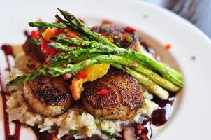 Plate of Scallops and Asparagus photo