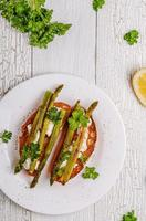 Bruschetta with goat cheese and grilled asparagus