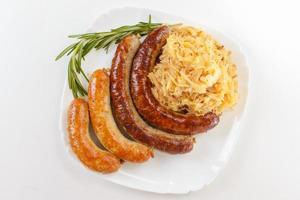 Oktoberfest menu, plate of sausages and sauerkraut