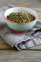 Mung Bean in a bowl on linen napkin, wooden backgrounds