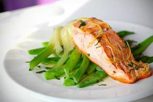 Salmon fillet with green beans and lemon zest. photo