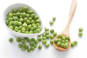 Green Peas in bowl isolated on white