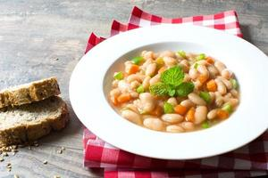 white beans with carrot and green pepper photo