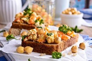 Sandwich with carrots, cheese and chickpeas photo