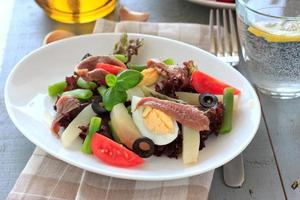 Mediterranean salad with anchovies and olives photo