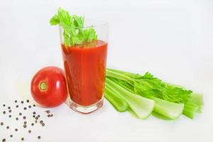 Glass of tomato juice with selery and pepper