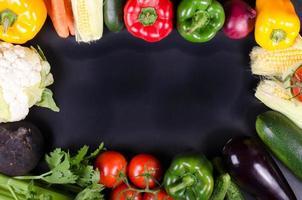 Fresh vegetables, autumn background. Healthy eating frame. photo
