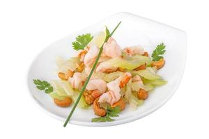 Meat tiger shrimps with vegetables and nuts photo