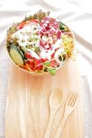 Salad with cream in wooden bowl photo