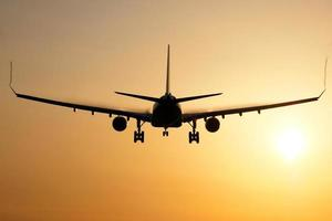 Airplane sunrise landing photo
