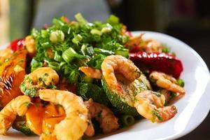 hot appetizer with vegetables and prawns photo