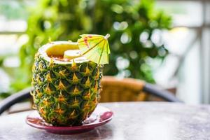Tropical cocktail in ananas