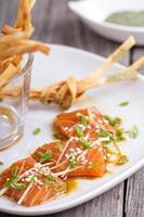 Salmon sashimi with ginger and sesame photo