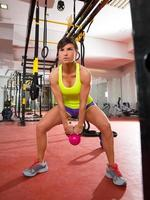 gym fitness Kettlebells swing exercise workout at gym photo