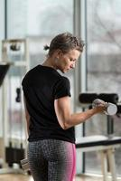 Young Woman Exercise With Dumbbells photo